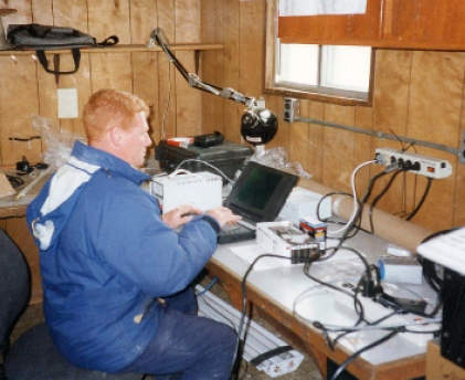 Photo of Jim Carrigan working at the observatory